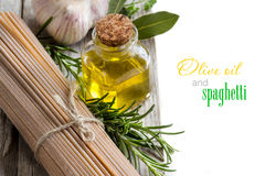 Whole wheat spaghetti, garlic, oilve oil and herbs Royalty Free Stock Photo