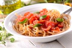 Whole wheat spaghetti with tomato Stock Photos