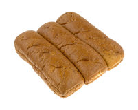 Whole wheat sub rolls on a white background. A group of freshly baked whole wheat sub rolls on a white background Royalty Free Stock Photos