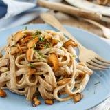 Whole wheat tagliolini with mushrooms Porcini. Whole wheat tagliolini with mushrooms  Porcini Stock Photo