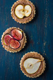 Whole wheat tarts  with chocolate frangipane, figs, apple and pe Royalty Free Stock Photography