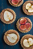 Whole wheat tarts  with chocolate frangipane, figs, apple and pe Stock Images