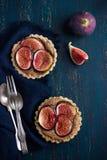 Whole wheat tarts  with chocolate frangipane and figs Stock Image