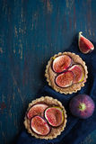 Whole wheat tarts  with chocolate frangipane and figs Royalty Free Stock Photography