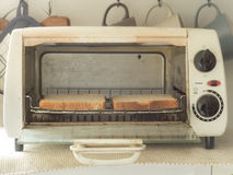 Whole wheat toast in the oven Stock Images