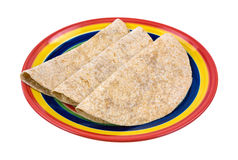 Whole wheat tortillas folded on plate Stock Photos