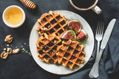Whole wheat waffles, honey and coffee royalty free stock image