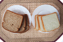 Whole Wheat and White Breads on Plates stock photos