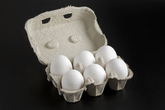 Whole White Eggs in Cartoon Box Stock Photos