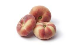 Whole wild flat peaches Royalty Free Stock Photos