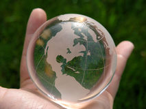 The whole world. A hand holding a glass globe Stock Photo