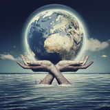 Whole world in her hands Stock Photos