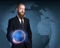 Whole world in his hands. Bearded mature businessman royalty free stock photography