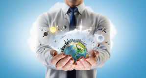 Whole world in his hands . Mixed media Stock Photography