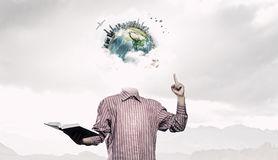 Whole world in his head . mixed media Royalty Free Stock Images