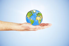 The whole world in your hand concept with hand and drawn earth  Royalty Free Stock Image