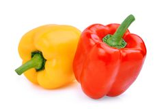 Whole of yellow adn red sweet bell pepper or capsicum isolated. On white background stock photography