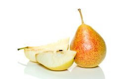 Whole yellow-red pear and few slices. Isolated on the white background Royalty Free Stock Image