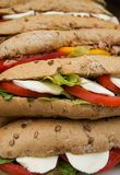 Wholegrain baguette with tomatoes, mozzarella and lettuce Stock Photography