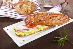 Wholegrain baguette on white tray. Stock Photography