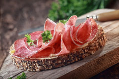 Wholegrain bread with spicy Italian salami Stock Images