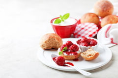 Wholegrain buns and chia seeds strawberry jam for breakfast Stock Image
