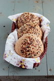 Wholegrain buns with flax and sesame seeds in the basket Stock Photo