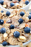 Wholegrain cornflakes with milk and blueberries Stock Photography