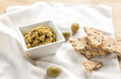 Wholegrain crackers with olive tapenade Royalty Free Stock Image
