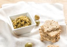 Wholegrain crackers with olive tapenade Stock Photo