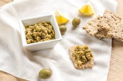Wholegrain crackers with olive tapenade Stock Images