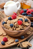 wholegrain flakes with berries, honey and milk Stock Photos
