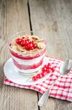 Wholegrain muesli with berry sauce and yogurt Stock Photo