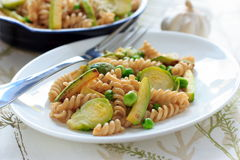 Wholegrain pasta with green beans, zucchini and Brussels sprouts Royalty Free Stock Photography