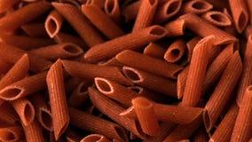 Wholegrain pasta pouring onto more stock video