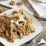 Wholegrain Pasta with topinambur cream, walnuts and zucchine Stock Photography