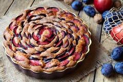 Wholegrain plum pie, damsonpie on the ceramic plate. Rustic style. Stock Photo