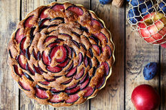 Wholegrain plum pie zwetschgendatschi on the ceramic plate. Rustic style. Top viev. royalty free stock images