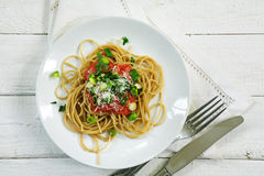 Wholegrain spaghetti with fresh tomato sauce and scallions seen Stock Images
