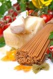 Wholegrain spaghetti, parmesan, tomatoes and oil Stock Image