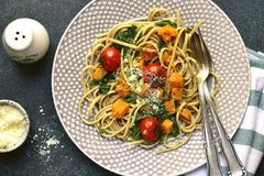 Wholegrain spaghetti with spinach,pumpkin and tomatoes.Top view Royalty Free Stock Photos