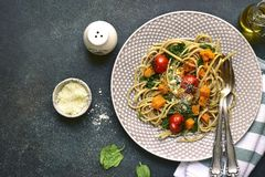 Wholegrain spaghetti with spinach,pumpkin and tomatoes.Top view Royalty Free Stock Image
