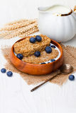 Wholegrain  wheat bisks with  milk and blueberry Royalty Free Stock Image