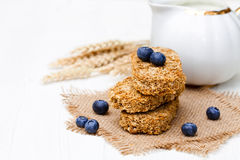 Wholegrain  wheat bisks with milk and blueberry Stock Photo