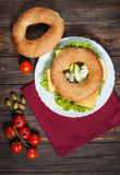 Wholemeal bagel with green pesto, fresh vegetables, cheese, tomato and pear Royalty Free Stock Photos
