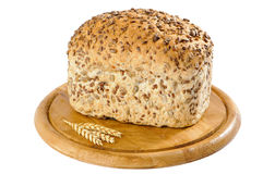Wholemeal Bread. With sunflower seeds on rustic board Stock Image