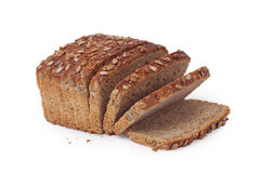 Wholemeal bread. Loaf of brown, wholemeal bread isolated on white background stock image