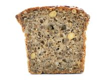 Wholemeal bread. Slice of wholemeal bread over white background Stock Images