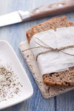 Wholemeal bread. Salt and pepper Royalty Free Stock Photo