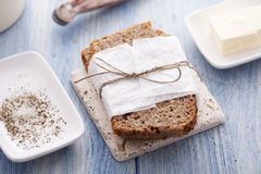 Wholemeal bread. Salt, pepper and butter Royalty Free Stock Image